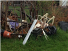 Pile of junk near fence