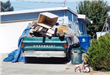 Broken down truck with garbage piled in back