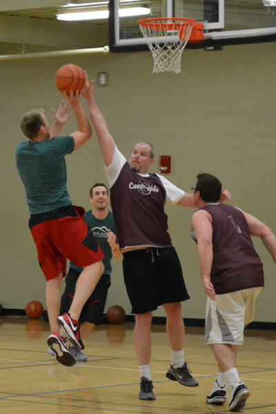 Men playing a game of 3 on 3 basketball
