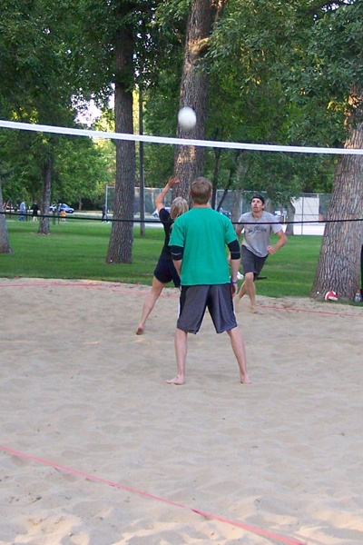Sand Volleyball team returning the ball