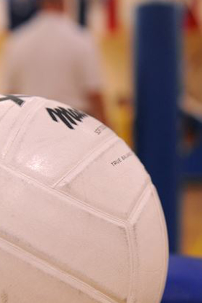 Close up of a white volleyball with a blurred background