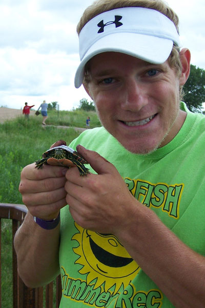 Summer Rec Staff holding a small turtle.