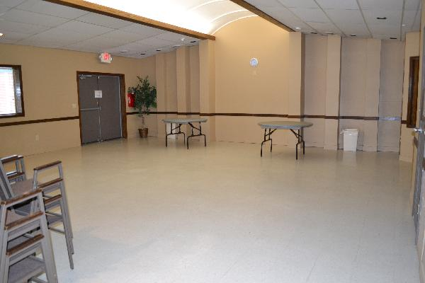 Larger meeting room at Hudson Street Hall with tables and chairs
